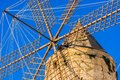 Spain Majorca island, old historical wind mill with wooden wings Royalty Free Stock Photo