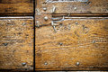 Close up of old metal nails in an ancient wooden door. Royalty Free Stock Photo