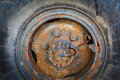 Close up of an old rusty wheel iso heavy processed for hdr tone mapping effect Stock Photo