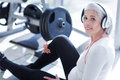 Close-up of old woman listening to music at gym Royalty Free Stock Photo