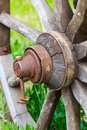 Close up old wooden cartwheel and green grass Royalty Free Stock Images