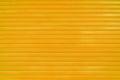 Close up orange metal sheet slide door texture background. Royalty Free Stock Photo