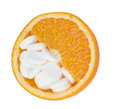 Close up of orange and pills isolated vitamin concept Royalty Free Stock Images