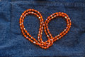 Close up orange plastic bead necklace Royalty Free Stock Photo