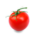 Close-up of organic, juicy, fresh, healthful bright red tomato,  on a white background. Vitamins. Plant of tomato. Royalty Free Stock Photo