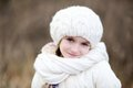 Close-up outdoor portrait of smiling little girl Royalty Free Stock Photo