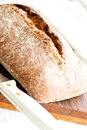 Close up oven baked home made bread on cutting board Stock Photography