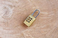 Close up pad lock on wooden background Royalty Free Stock Photo