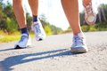 Close up pair feet runners Royalty Free Stock Photography