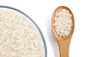 Close up of parboiled rice in glass bowl and wooden spoon Royalty Free Stock Photo