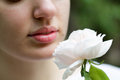 Close up part of  girl face breathes scent of rose Royalty Free Stock Photo