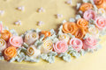 Close up pastel colored cream flowers cake decoration Royalty Free Stock Photo