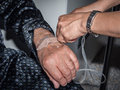 Close up of patient`s hand with iv drip inserted by nurse`s hand Royalty Free Stock Photo