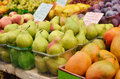 Close up of pears on market stand and other fruits in israel Stock Photos