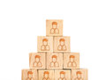 Close up at People profile icon on wood cube arrange in pyramid Royalty Free Stock Photo