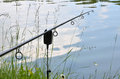 Close up photo of angling rod over the water Royalty Free Stock Images