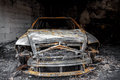 Close up photo of a burned out car in garage after fire for grunge use Royalty Free Stock Photo
