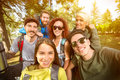 Close up photo of group of youngsters in nature cheerful Stock Images