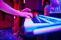 Close-up photo of musician`s hands playing the synthesizer in th Royalty Free Stock Photo