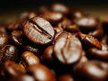 Close-up photo roasted coffee beans with focus on one seed Royalty Free Stock Photo