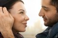 Close up photo of romantic couple closeup kissing side view Royalty Free Stock Photo
