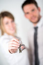 Close up picture of cheerful young realtor couple holding house keys Stock Images
