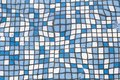 Close up picture of small square blue and white shiny ceramic tiles. Background, bathrooms and pools walls and floor design. Royalty Free Stock Photo
