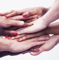 Close up on a pile of hands on top of each other multi ethnic group of people studio shot Stock Photo