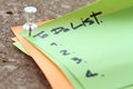 Close up on pin and to do list word on sticky note with cork boa of board as concept Stock Photo