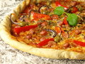 Close-up of pizza with vegetables and sausages Stock Photography