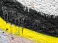 Close up of plastered painted old wall small part hoarse with white pink yellow and black paint colourful abstract background Royalty Free Stock Photos