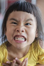 Close up playful  funny face of asian   children grin ,toothy face Royalty Free Stock Photo