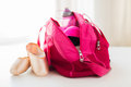 Close up of pointe shoes and sports bag Royalty Free Stock Photo