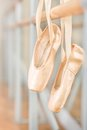 Close up of pointes for ballet hanging on barre near the mirrors in classroom Royalty Free Stock Image