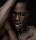 Close up portrait african american man water dripping down face Stock Photography