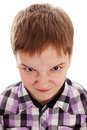 Close up portrait of angry little boy isolated on white background Royalty Free Stock Photo