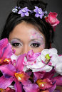 Close-up portrait of asian girl with flowers Stock Images