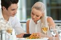 Close up portrait attractive couple looking smart phone restaurant Royalty Free Stock Photo