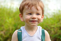 Close up portrait baby boy cheeky smiling face expression Royalty Free Stock Photo
