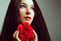 Close up portrait beautiful brunette woman red rose red Stock Image