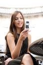 Close up portrait beautiful businesswoman using cell phone sitting classic coffee shop smiling Stock Photo