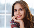 Close up portrait of a beautiful cute teen girl smilling indoor Stock Image