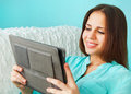 Close up portrait of a beautiful cute teen girl smilling with tablet computer Stock Image