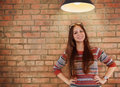 Close up portrait of a beautiful cute teen girl smilling undre the lamp Stock Photos