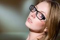 Close-up portrait of beautiful girl in glasses