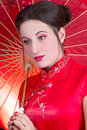 Close up portrait of beautiful woman in red japanese dress with young umbrella Royalty Free Stock Image