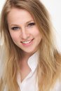 Close up portrait of a beautiful young blond woman smiling Royalty Free Stock Photo