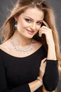 Close-up portrait of beautiful young woman with luxury jewelry and perfect make up Royalty Free Stock Photo