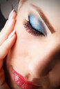 Close up portrait of beautiful young woman with make up blue Stock Image