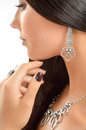 Close-up portrait beautiful young woman wearing luxury jewelry. Royalty Free Stock Photo